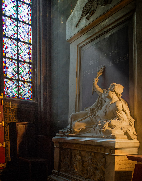 Behind the altar of Notre Dame lies the tomb of Denis-Auguste Affre, 27 September 1793 – 27 June 1848.  Archbishop of Paris, he was killed while trying to negotiate peace during the uprising of 1848.