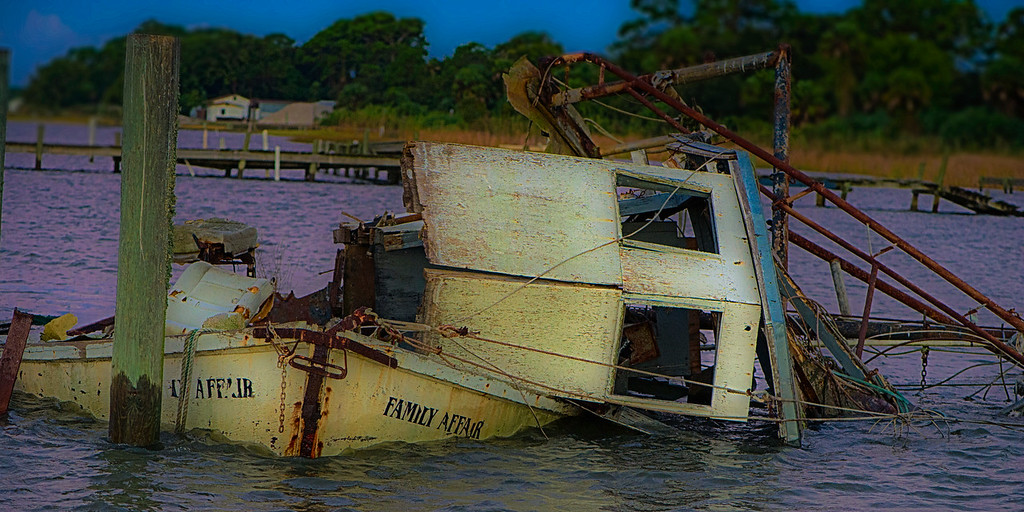 Old Shrimp boat, beached, stripped and gone to ruin