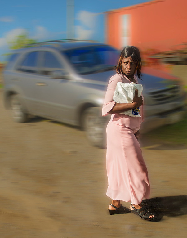 St Kitts,  woman going home from church